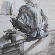 Homme assis dans la lumière