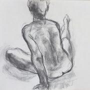 Jeune-homme assis vu de dos